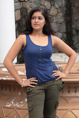 Meghana Raj hot tight sleveless dress stills