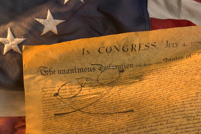 Image shows a portion of the Declaration of Independence.