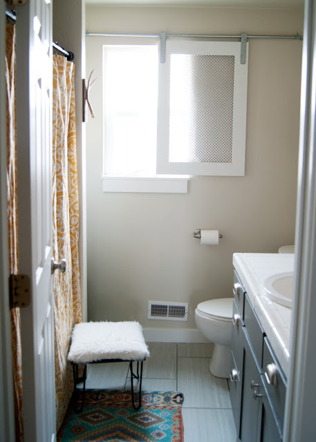 Bathroom Makeover - before & after - World Market rug / mat and vintage hairpin leg stool and DIY barn door window covering