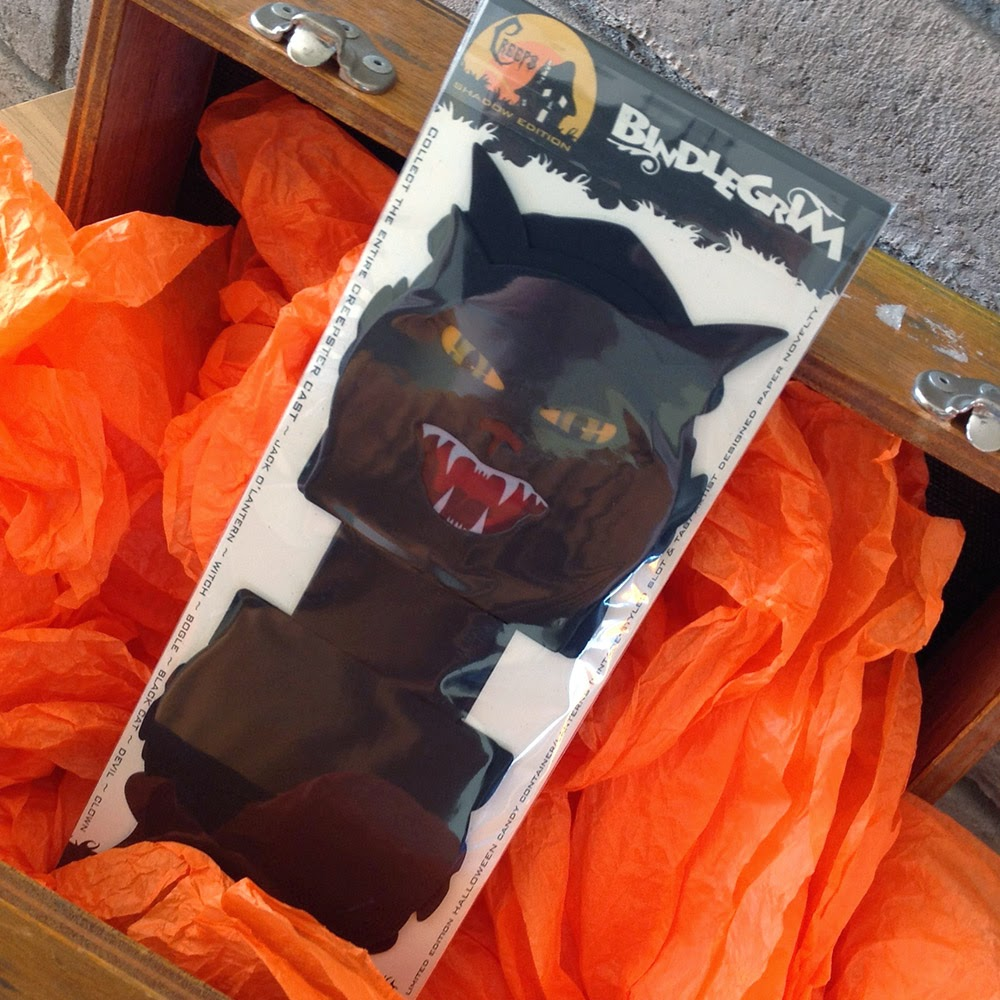 #3/5 limited edition set of halloween paper ephermera displayed in old crate box andd orange crepe paper.