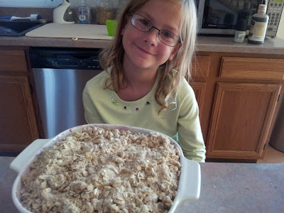 Little Miss modeling her glasses while baking