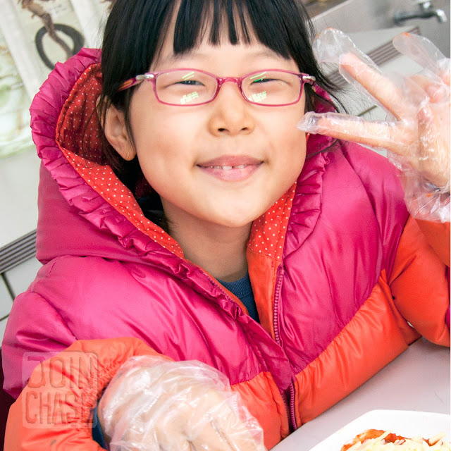 A student making a pizza sandwich during Winter English Camp at Bibong Elementary in Ochang, South Korea.