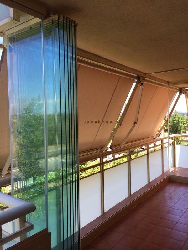 Kasabona cerramiento de terraza en salou con cortinas de for Cortina cristal terraza