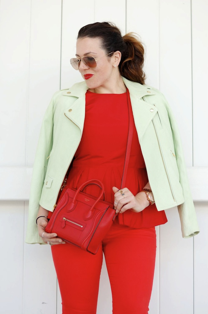 Cherry-hued Tibi peplum and Celine Nano heat up with a green leather Theory jacket