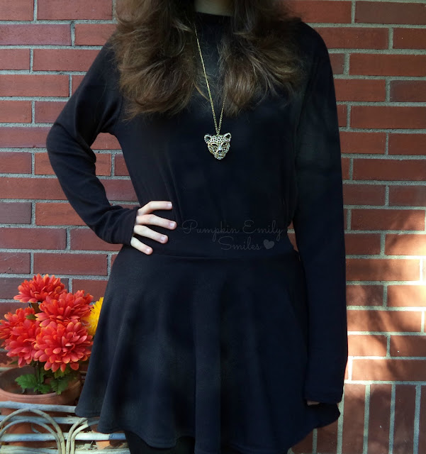 Black t-shirt, skirt, and golden necklace
