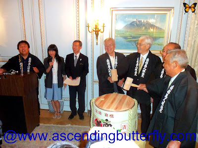 Podium Speaker: Mr. Kosuke Kuji to his right is a translator, Center: Ambassador Sumio Kusaka preparing to break the ceremonial drum at the Ninohe City Reception in New York City