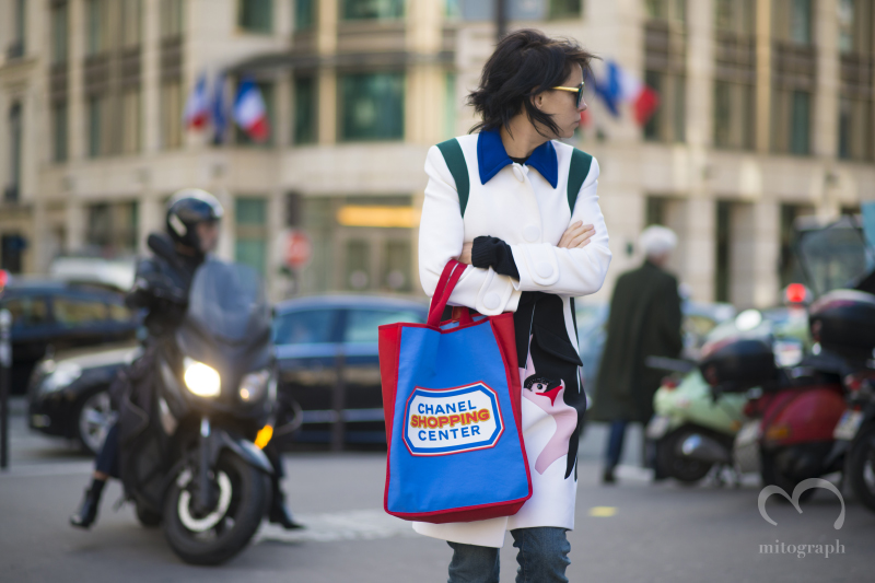 Charlotte Stockdale wears Prada Coat and Chanel Shopping Center Tote Bag during Paris Fashion Week PFW