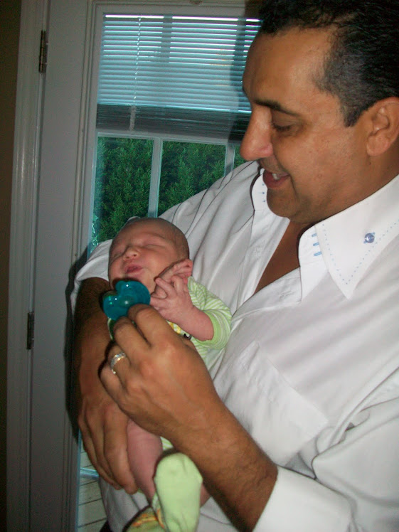 Andres with Daddy (just a few days old)
