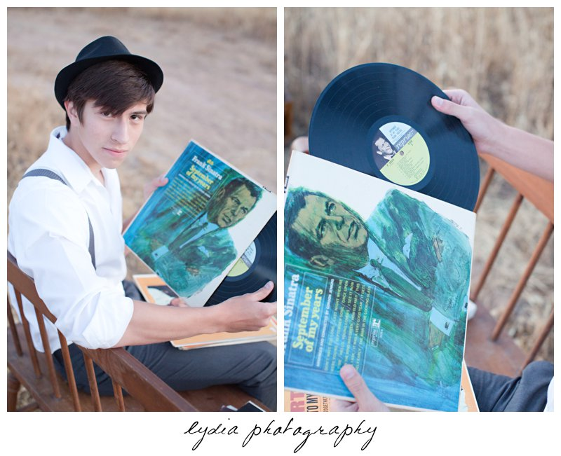 Senior guy with an old record at Forest Lake Christian senior lifestyle portraits in Rocklin, California