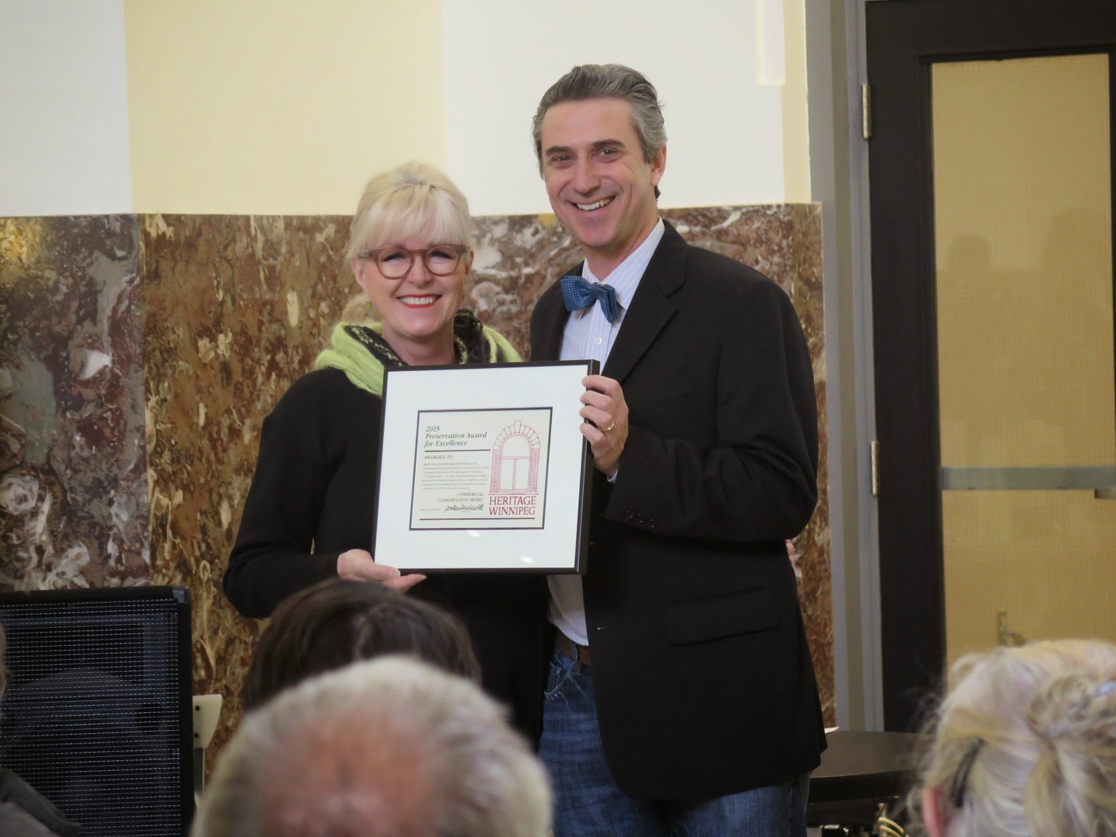 Architect John Van Leeuwen accepts award from HW Board Member Lisa Gardewine.
