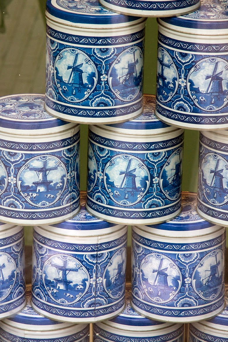 stacked blue cans containing a Dutch delicacy