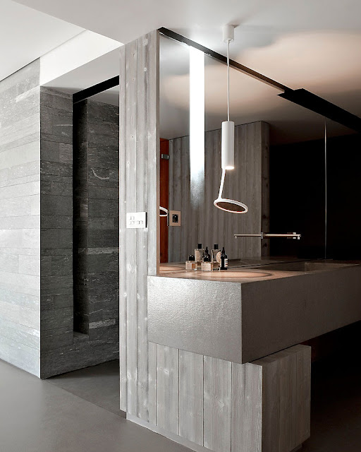 Silver Stainless Faucet and Reflective Mirror Panel on the Wall