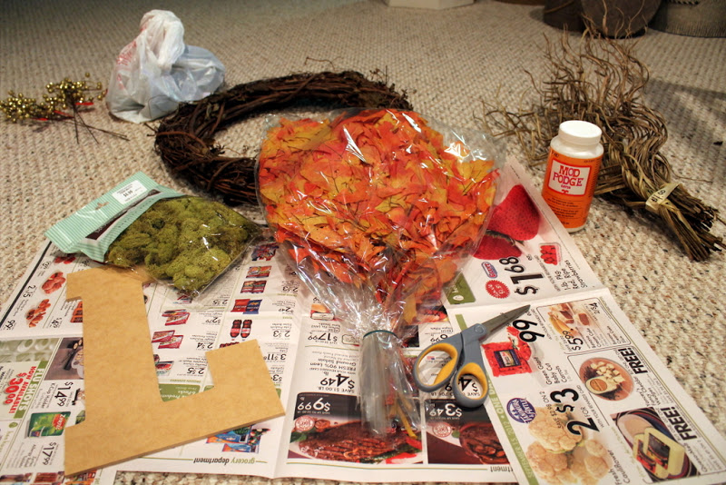 wooden or paper mache letter 1 bag of clumped moss 1 bunch of autumn colored leaves fake or preserved any other fillers you may want like the gold balls