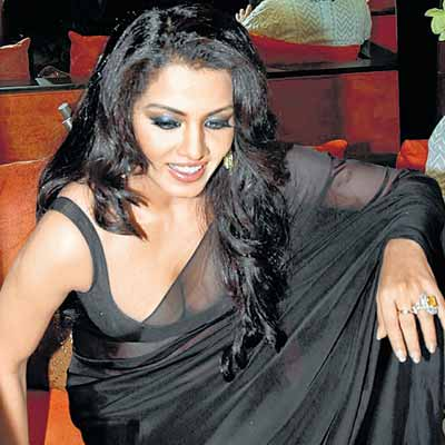 ... Photos: Bollywood Actress Celina Jaitley in Transparent Black Saree