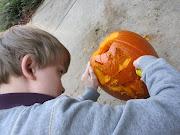 Lars Carving his Pumpkin