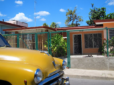 Santiago de Cuba Vista Alegre yellow car orange house blue sky