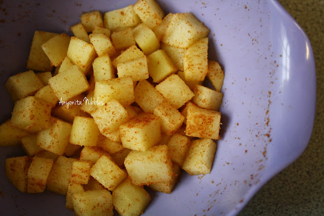 Toss the potatoes in onion and garlic powder and paprika
