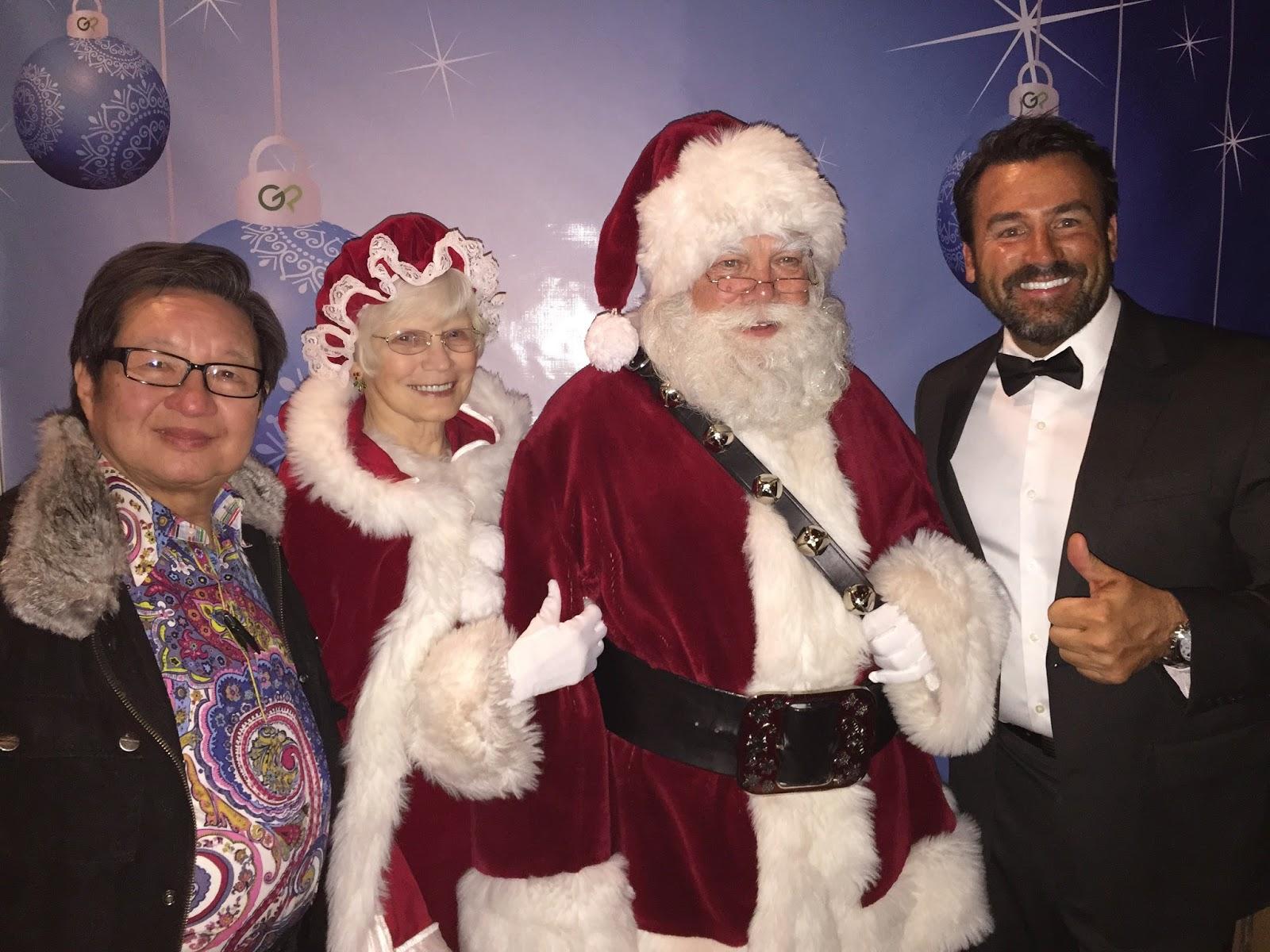 Santa Claus and GotPrint crew posing for camera