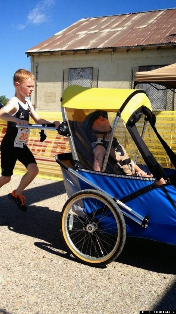 Love his dedication! - This is Noah who's 8. He carried his disabled 6 year old brother through a triathlon.