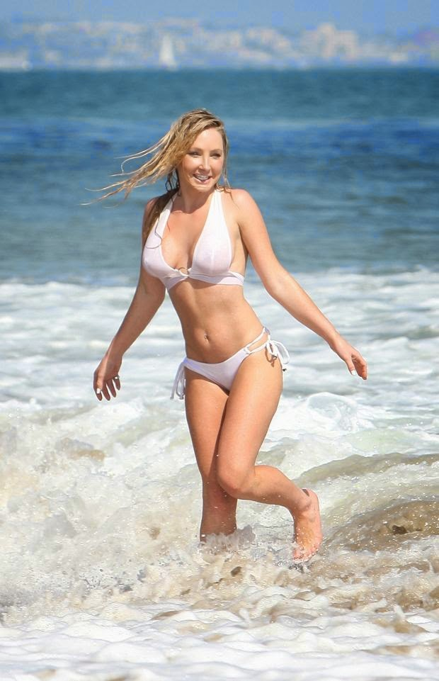 Nikki Lund wears a white bikini at Malibu on Tuesday, June 24, 2014