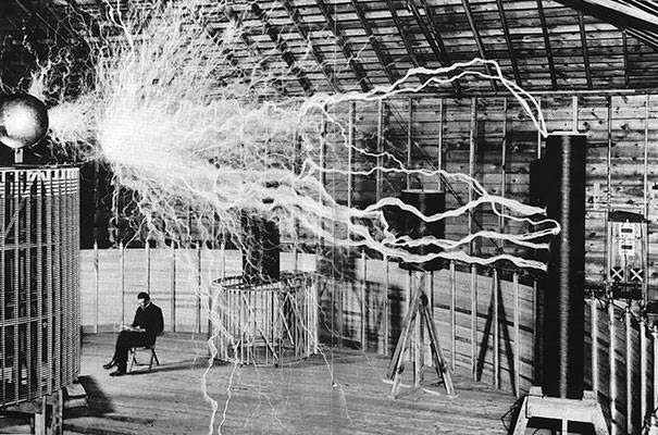 "These 15 Incredibly Rare Historical Photos Will Leave You Speechless - Nikola Tesla sitting in his laboratory with his ""Magnifying Transmitter."""