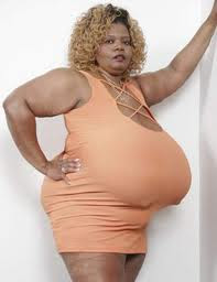 Norma Stitz posing with her huge breasts