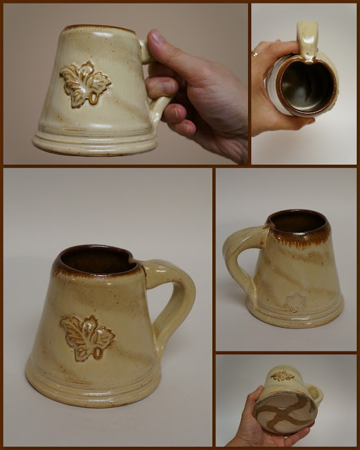 Ceramic pottery beer weisen mug stein with marbled design.