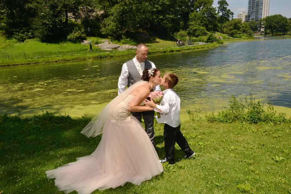 Bride kisses Ring Bearer by Lake