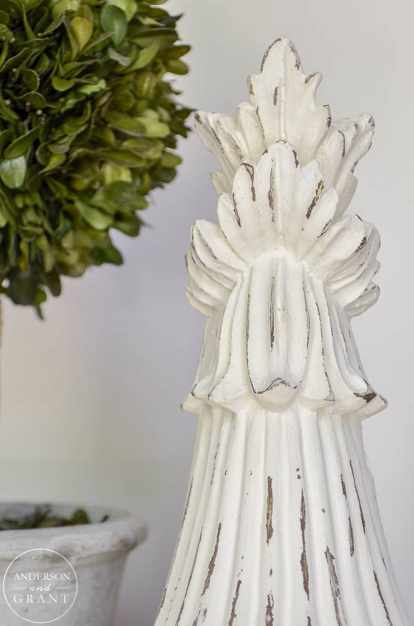 Carved wood corbel with distressed paint.  |  www.andersonandgrant.com