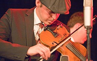 Fiddler playing fiddle free image from Wikimedia