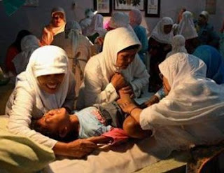 "In Indonesia, an infant girl undergoes ""sunat"" to fulfill religious"