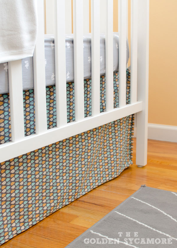 I bought this cute fabric for the crib skirt from JoAnn Fabric. I usually  let my husband help me pick out home stuff because, well, it's his house  too, ... - Nursery Progress : DIY Crib Skirt And Lazy Mitered Corner Hem