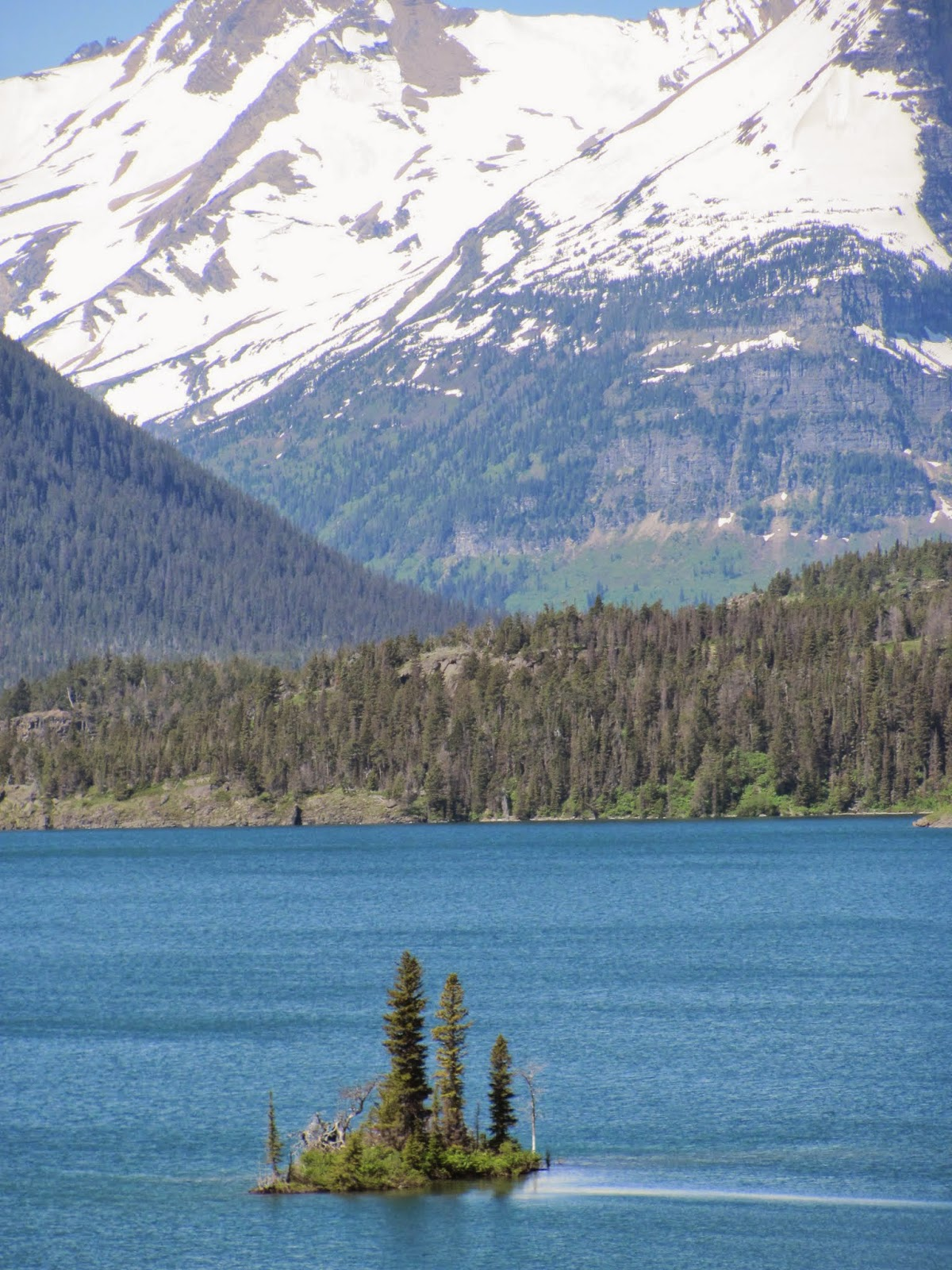 Lone Goose Island stands out on the surface of St. Mary Lake at Glacier National Park in Montana