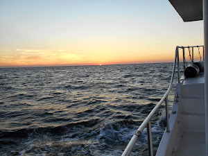 Sunset on a pretty much calmed down  Gulf of Mexico.