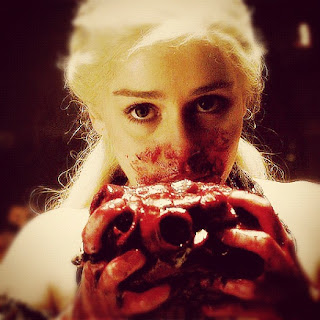 bloody Daenerys eating raw horse hart