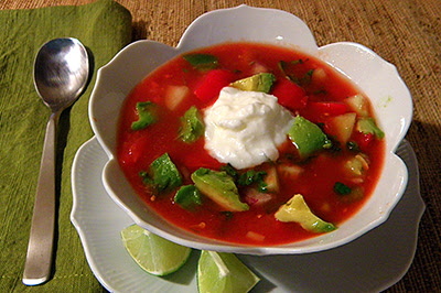 Bowl of Gazpacho with Avocado and Yogurt Garnish