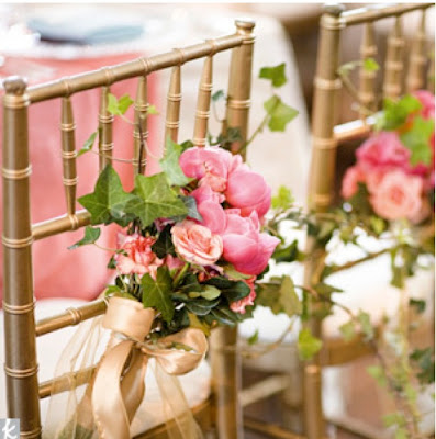 or clamped to folding chairs at an outside wedding