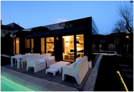 Minimalist Terrace Design in black modular house