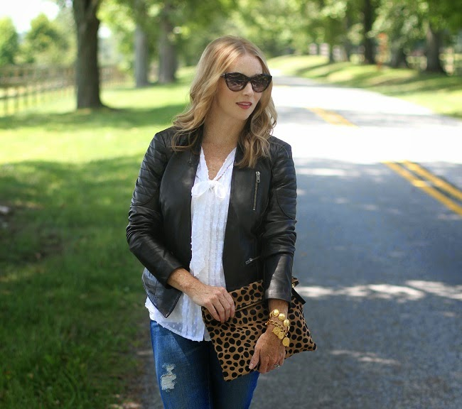 saint laurent sunglasses, halogen leather jacket, loft swiss dot blouse, clare vivier clutch, julie vos necklace