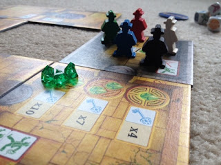 Escape: The Curse of the Temple board game meeples