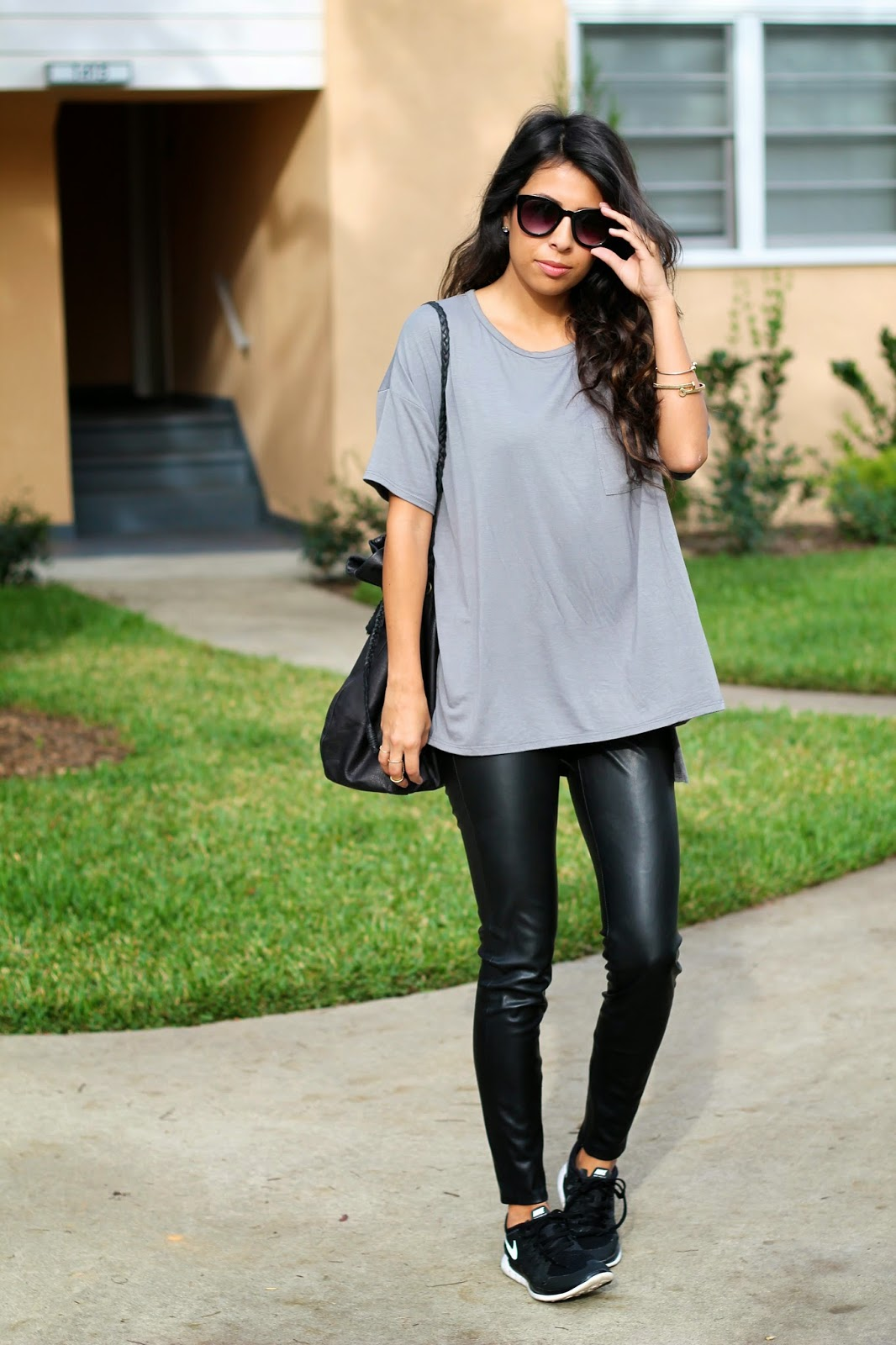 styling tennis shoes, holiday shopping outfit, casual outfit, leather pants, nike frees,