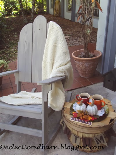 Eclectic Red Barn: Rocking chair with throw and tea and fall accessories
