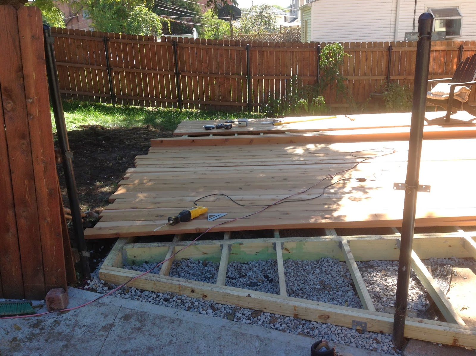 Building a low ground cedar deck before and after brookside for How to build a low deck