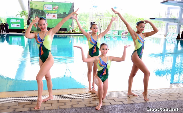 Malaysian synchronized swimmers posing before their performance
