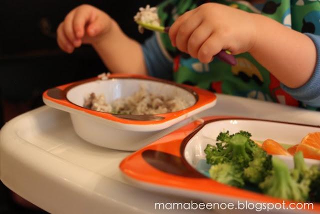toddler feeding himself