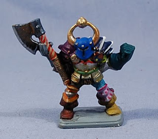 A painted model of a chaos warrior of Tzeentch