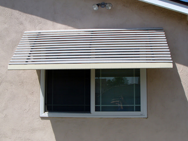 Aluminum window awnings by The Sunshine Grove