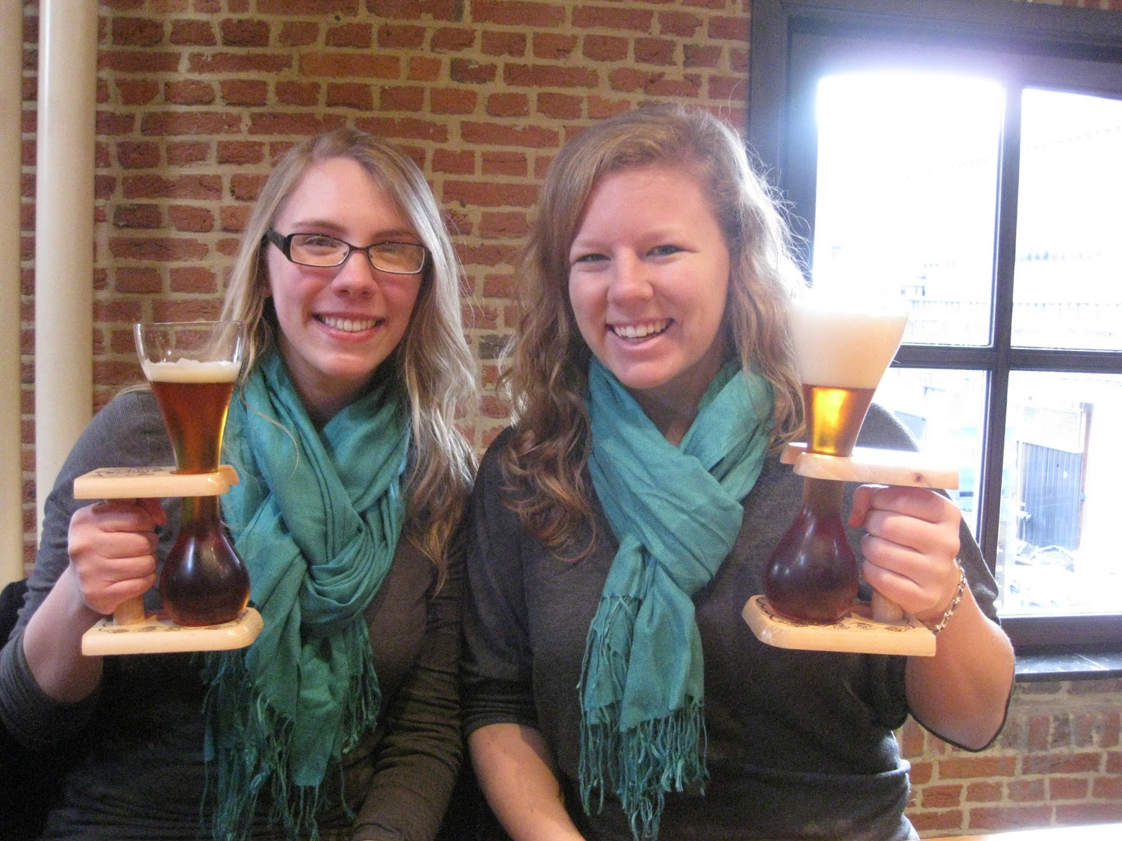 Two American women holding Kwak beers by the fram