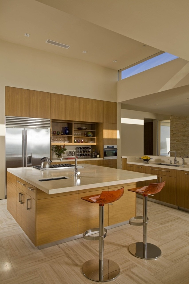 Photo of kitchen island with bar chairs