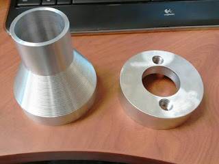 6061-T6 aluminum flanges by machinist at 23b